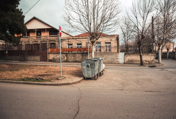 Fotomurales - View on old Tbilisi streets and garbage bins