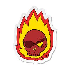 sticker of a cartoon burning skull