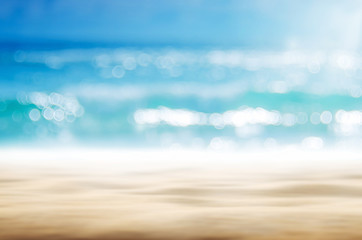 Spoed Foto op Canvas Strand Blur tropical beach with bokeh sun light wave abstract background.