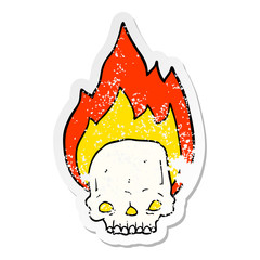 distressed sticker of a spooky cartoon flaming skull