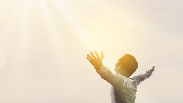 Copy space of happy man raise hands on  sky white cloud with sun light abstract background.