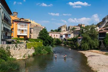 People cooling off in Ega river, Estella or Lizarra, Navarre region, Northern Spain