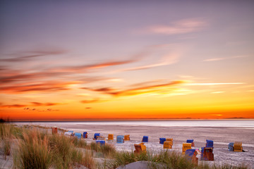 Fototapete - Sunset at the beach on the East Frisian Island Juist in the North Sea, Germany.
