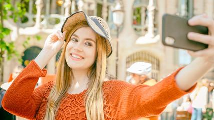 Happy girl making selfie outdoor