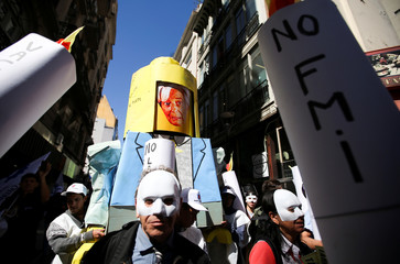 Demonstrators hold a LEGO made of paperboard with a picture depicting IMF International Monetary Fund (IMF) Managing Director, Christine Lagarde, during a protest against the increase of public rates, in Buenos Aires