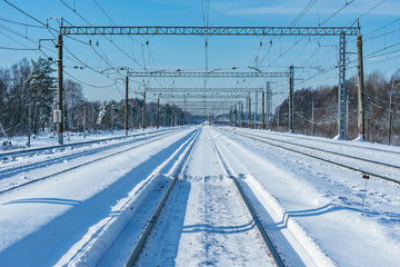 Electric railway lines at winter day time.