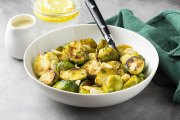 Roasted Brussels sprouts with peanuts and white sauce, delicious vegetarian lunch. Healthy, organic food, vegetable garnish