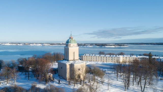 Beautiful old lighthouse and church in Suomenlinna at winter season, Helsinki