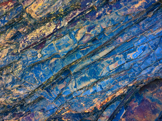 stone texture of amazing color, rocky layers of bright colors