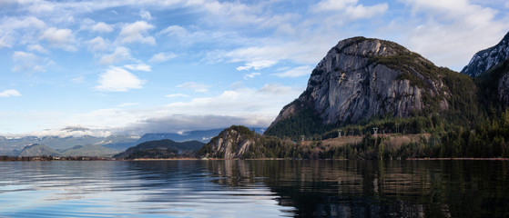 Beautiful panoramic Canadian landscape view of a popular landmark, Chief Mountain, during a cloudy sunny day. Taken in Squamish, North of Vancouver, BC, Canada.