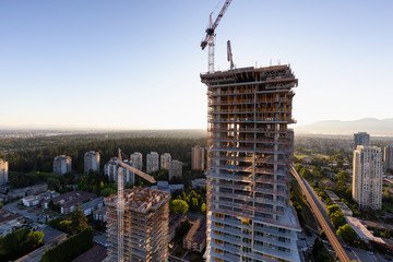 Aerial view of a residential building construction site during a vibrant summer sunset. Taken in Burnaby, Vancouver, BC, Canada. Fototapete
