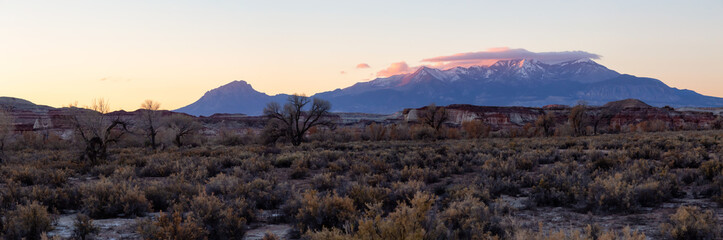 Beautiful American Landscape during a vibrant sunny sunrise. Taken near Hanksville, Utah, United States of America.