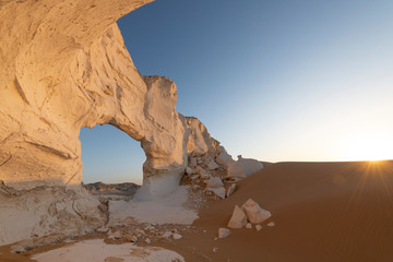 Sunset landscape with chalck rock formations at the White desert national park in Egypt