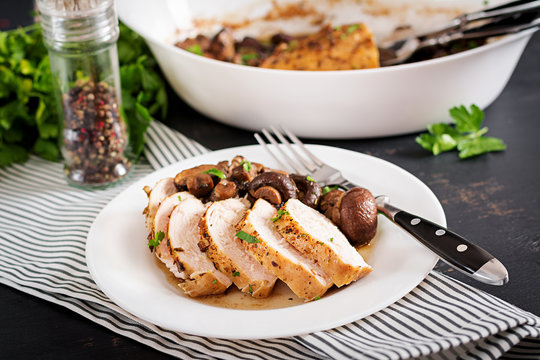 Baked chicken breast with mushrooms in balsamic  sauce  on the table.