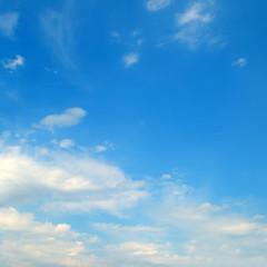 Cumulus clouds in the blue sky.