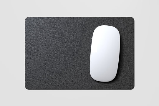 Computer mouse and mouse pad isolated on white background. 3d rendering.