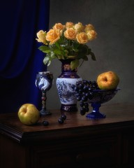 Still life with bouquet of yellow roses and fruits