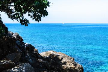 Coastline cliffside view of the ocean. Caribbean tropical island landscape/seascape scenery.