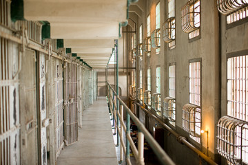 Cells of an empty derelict prison.