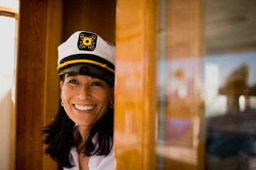 Mature woman wearing a sailor's hat and smiling