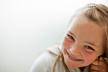 Portrait of a giggling young girl.