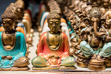 Buddha statue figures sold as a souvenir on a market