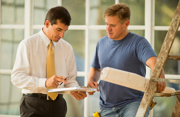 Businessman and contractor discussing a project.