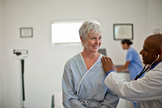 Mature woman undergoing a medical exam with her doctor.