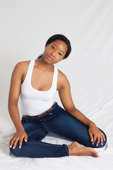 Pensive Black woman sitting quietly
