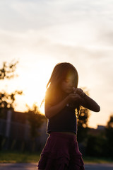 Young girl outdoor at sunset