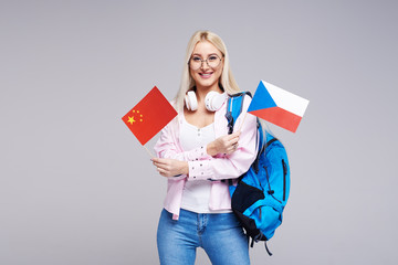 Education, foreign language translator, english, student - smiling blond woman in headphones...