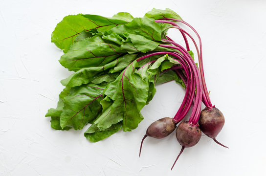 Young beets on concrete background