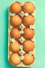 Easter eggs lie in a vintage tray on a blue background. Easter ideas. Space for text. Happy easter. Toned image.