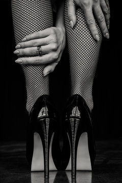 Woman legs in black stockings and high heels shoes