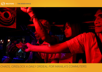 The Wider Image: Chaos, gridlock a daily ordeal for Manila's commuters