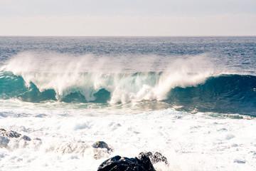 Fantastic waves tube rolls over the coast