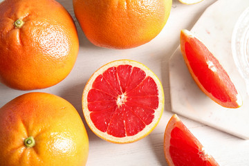 Flat lay composition with grapefruits on wooden background