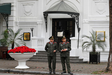 Vietnamese police are seen outside the French colonial-era Sofitel Legend Metropole Hotel in Hanoi