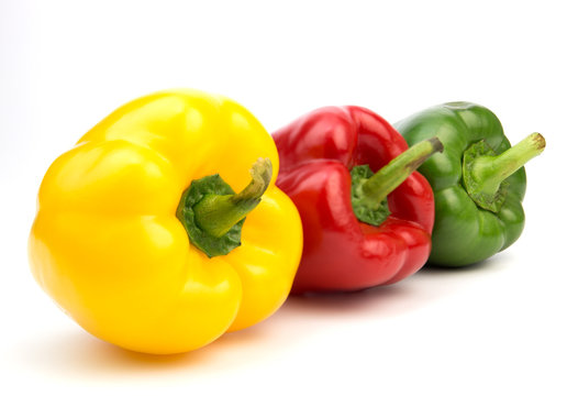 Yellow, red, green, fresh bell pepper isolated on white background