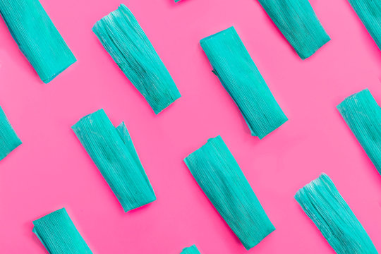 Colorful pattern with blue tamales on pink background. Top View. Copy Space. Pop art design.