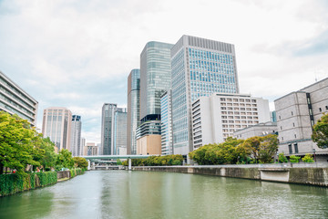 Modern business buildings and canal near Yodoyabashi station in Osaka, Japan