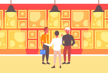 businessmen group having meeting three business men talking about new project standing together art gallery interior partnership concept flat full length horizontal