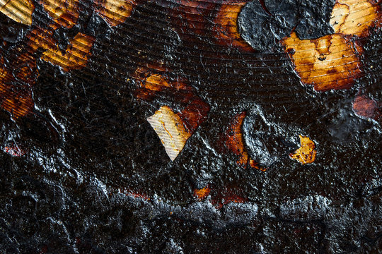 black soot on a metal surface close-up industrial background