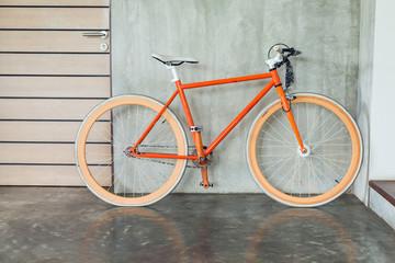 Foto op Plexiglas Fiets orange bicycle parked decorate interior living room modern style