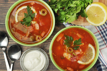 Two bowls with traditional Russian soup solyanka