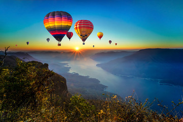 Colorful hot air balloons flying over mountain and Ping River at Pha Daeng Luang, Mae Ping National Park, Lamphun in Thailand