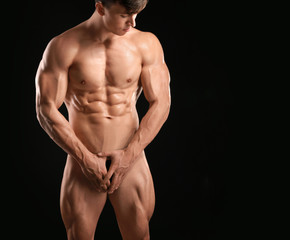 Muscular sexy bodybuilder on dark background