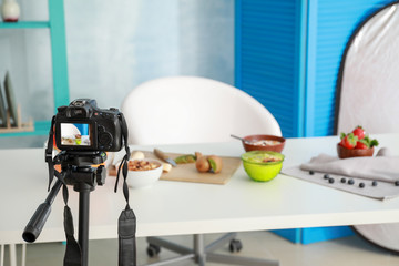 Workplace of food blogger with modern camera
