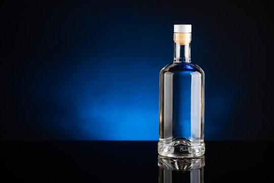 bottle of vodka on black background