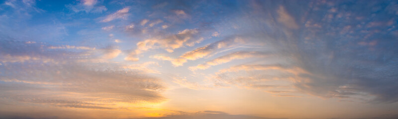beautiful clouds in warm pastel colors during sunrise - high resolution panorama